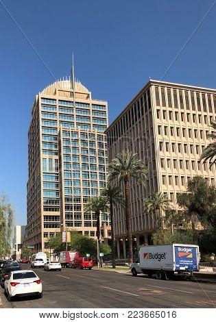 PHOENIX, AZ, USA - DECEMBER 14, 2017: Distinctive architecture of Phoenix City Hall vs municipal building of Calvin Goode as seen from 3rd Avenue and Jefferson Street in Phoenix downtown, Arizona