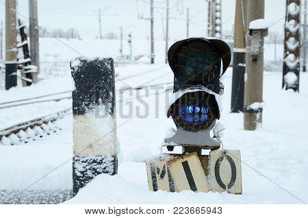 Semaphore is located on the motorway crossing the railway line in winter season