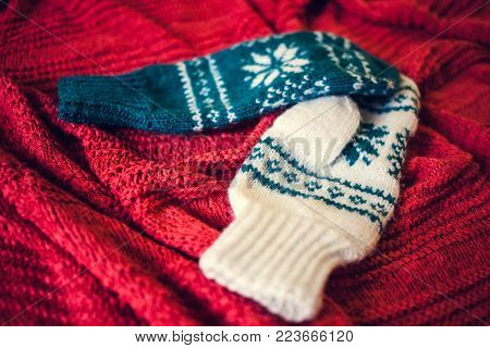 Two Knitted Mittens.