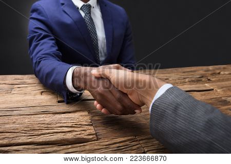 Close-up Of A Businessman's Hand Shaking Hand With His Partner