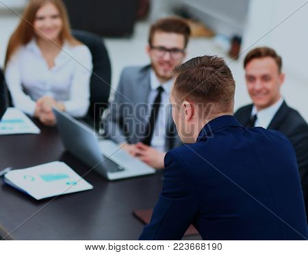 Businesspeople at business meeting, seminar or conference.