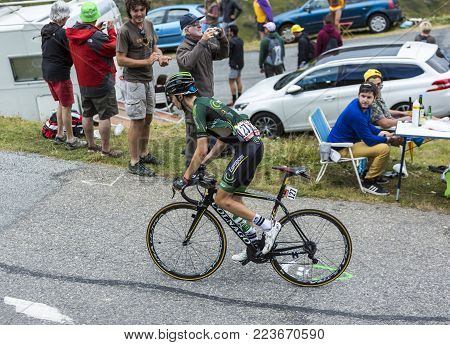 Col du Glandon, France - July 24, 2015: The French cyclist Romain Sicard of Europcar Team,climbing the road to Col du Glandon in Alps, during the stage 19 of Le Tour de France 2015.