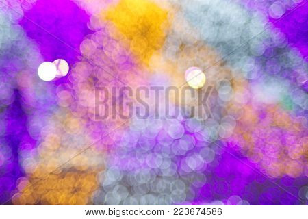 Colorful bokeh circular light diffused background for christmas, new year or celebration theme.