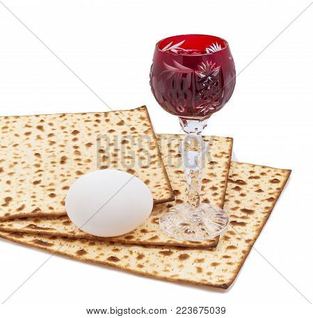 Traditional food (matzah), eggs and drink (red wine) for Jewish Passover Holiday