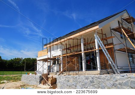Unfinished House. Home Remodeling And Renovation. Painting House Wall With Stucco And Plastering. In