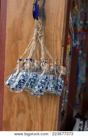 Evil eye bead in bottle as  souvenir  from Turkey