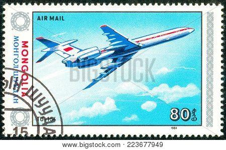 Ukraine - circa 2018: A postage stamp printed in Mongolia show aircraft Tu-154. Series: Airplanes. Circa 1984