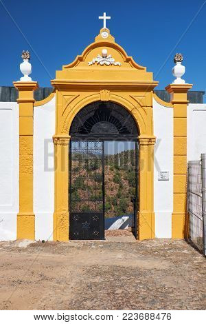 The main gate of the cemetery near the main church dedicated to Our Lady of the Annunciation in Mertola. Portugal