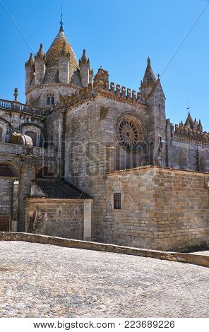 The view of Cathedral of Evora (Se de Evora) – a Roman Catholic church whose real name is Basilica Cathedral of Our Lady of Assumption. Evora. Portugal