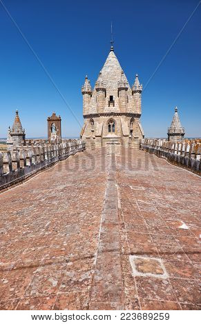 The view of the lantern tower over the gable roof of Evora Cathedral (Basilica Cathedral of Our Lady of Assumption). Evora. Portugal
