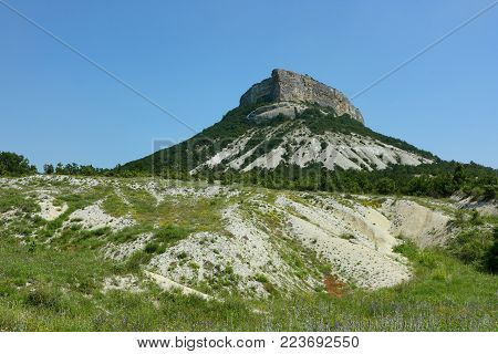 Kyz-Kermen mountain, Crimea. The mountain is part of the inner ridge of Crimean mountains. Caverns of the mountains were used for houses in ancient times.