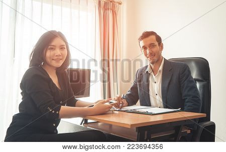 Two office worker male and female facing camera, Business team concept