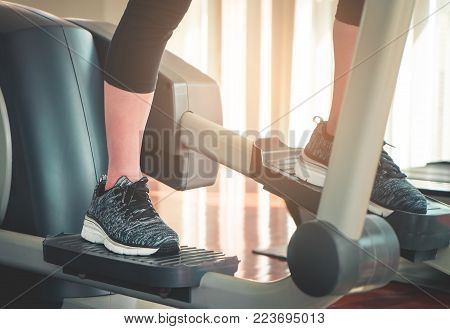 Foot working out on stepper exercise machine
