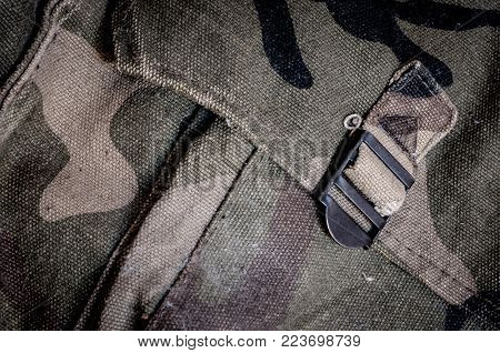 Old camouflage army bag for background or banner