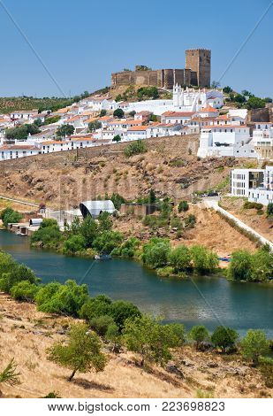 The view of Mertola town with the old mediaeval castle on the hill. Baixo Alentejo. Portugal