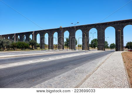 The stone aqueduct of Silver Water (Prata Aqueduct)  outside the walls of Evora. Evora aqueduct is  the rebuilt old Roman aqueduct bringing clear water to the city center. Evora. Portugal