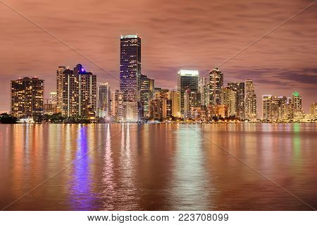 Miami bayfront skyline at night with actual reflections in water