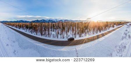 beautiful view of car on winter road and snow at sunset near lake Baikal, russian federation