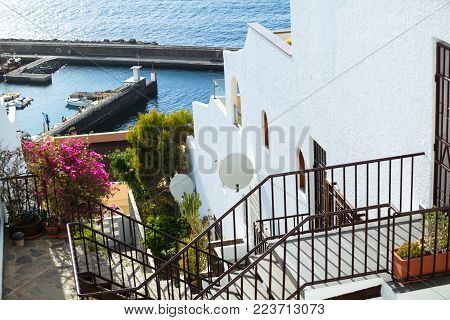 residential apartments with sea port of Los Gigantes in the background, Tenerife, Spain