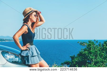Young woman enjoying the view on a cliff