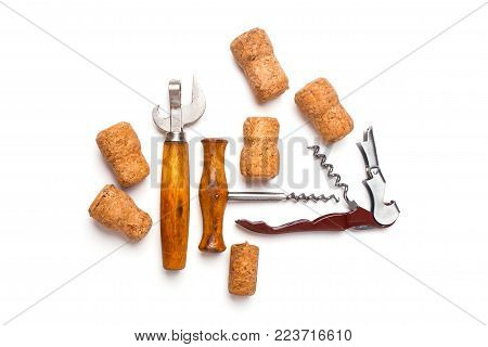 Bottle corks, bottle opener and corkscrew isolated on white background