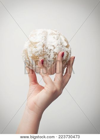 Woman holds the peeled pomelo on a neutral background