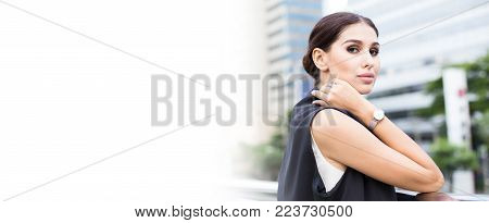 Young Beautiful Business Woman In City Looking Out And Thinking About Work. Young Business Woman Wit