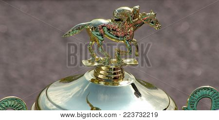 Pyatigorsk, Russia - Jule 08,2011:Classic Gold Cup with the image of a jockey on a horse, a pedestal with the engraved inscription