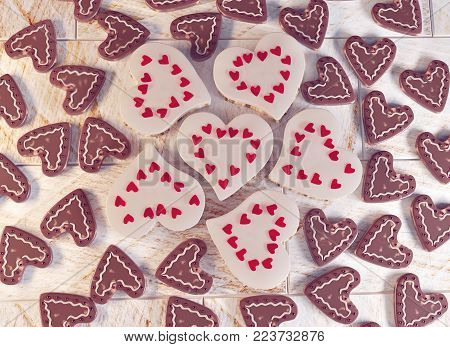 3D rendering. Festive chocolate hearts. Lots of chocolate and sponge hearts. Valentine's day very soon. Greeting card.