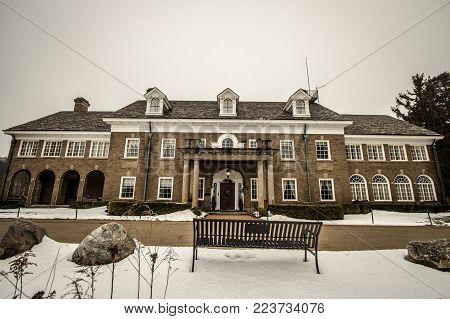 Saugatuck, Michigan, USA - January 21, 2018: The reportedly haunted Felt Mansion has been utilized as a private home, seminary and a prison. It is now a historical venue hosting weddings, tours, events and ghost hunts.