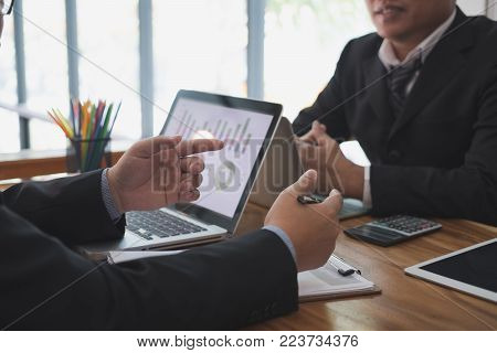 business adviser analyzing company financial report. professional investor discussing balance sheet statement. businessman working on new startup project with co working team.