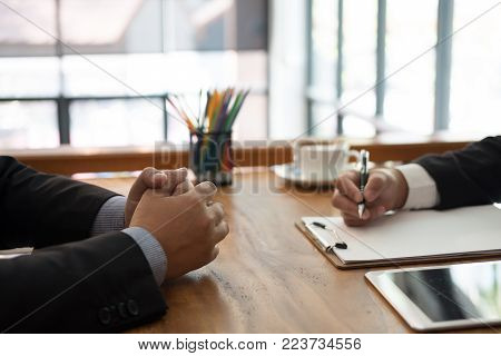 businessman talking to candidate in job interview. manager listen to applicant answer. employer asking job seeker about his performance at company