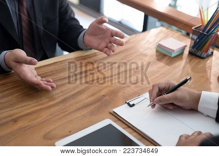 businessman talking to candidate in job interview. manager listen to applicant answer. job seeker explaining his performance to employer at company