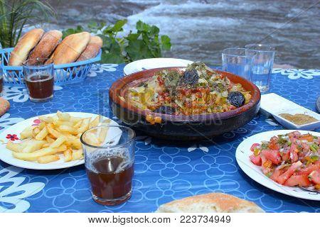 Moroccan dinner. tajine, olive, traditional mint tea, salad and bread.