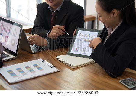 business adviser analyzing company financial report. professional investor discussing balance sheet data. businessman & businesswoman working on new startup project with co working team.
