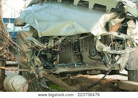 Car crash accident. Front side of broken and damaged car wreck in crash accident with fatal outcome in collision