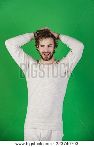 Barber And Hairdresser, Male Fashion. Sleepy Man With Beard On Green Background. Man With Disheveled