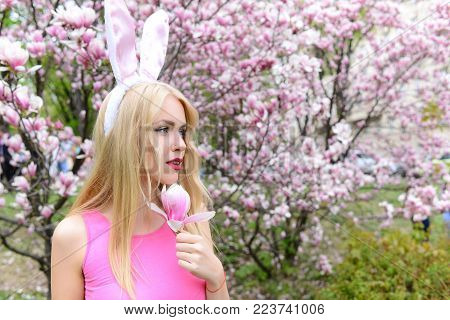 Spring. Cute Girl Or Pretty Woman With Pink, Bunny Ears On Long, Blond Hair In Rosy Top Holding Magn