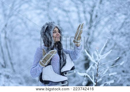 Ice Skating Concept. Woman Happy Smile With Figure Skates At Trees In Snow. Vacation, Holidays, Hobb