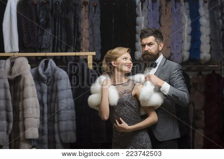 Woman In Fur Coat With Man, Shopping, Seller And Customer. Date, Couple, Love, Man And Woman. Couple