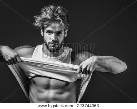 Handsome Guy Fashion Sexy Young Bearded Macho Man Model In White Vest Has Bare Muscular Torso And Ch