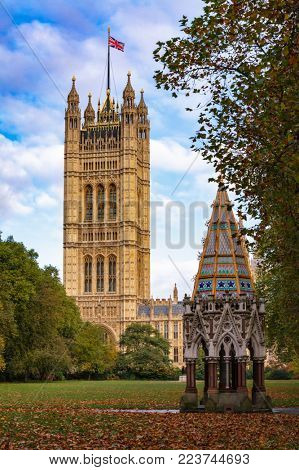 Buxton Memorial Fountain, a memorial and drinking fountain in Victoria Tower Gardens public park with The Victoria Tower of the Palace of Westminster, City of Westminster, London UK