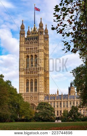 The Victoria Tower at the south-west end of the Palace of Westminster as viewed from the Victoria Tower Gardens public park, City of Westminster, Central Area of Greater London UK