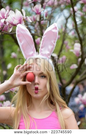 Funny Girl Or Cute Woman With Long, Blond Hair Making Fish Face, Lips, Grimace With Red Egg In Rosy,