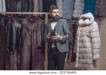Fashion and beauty, winter, fur. fashion, business and shopping, man among fur coat