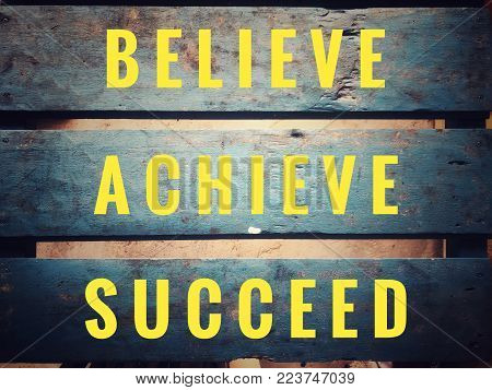 Motivational and inspirational quotes - Believe, achieve, succeed. With vintage styled background.