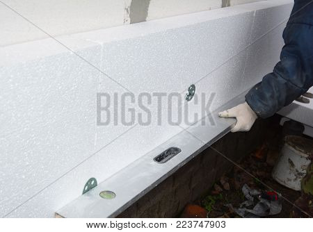 Builder install Styrofoam insulation board. House  Wall Polystyrene Insulation.  Rigid extruded polystyrene insulation.