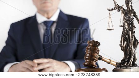 Law And Justice Theme. Legal Counsellor. Mallet And Themis Statue On White Table And Background.