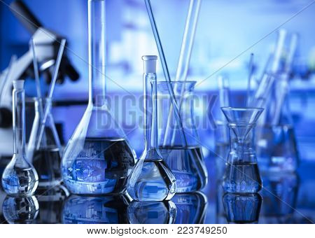 Laboratory concept. Science experiment. Laboratory glassware, microscope.