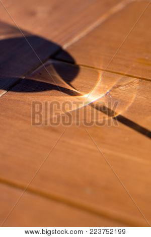 Glass of White Wine Shadow on Wooden Table